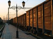 picture of boxcar  - Boxcars passing by along the lonely platform with lanterns - JPG