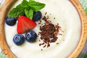 overhead view of oatmeal with fresh fruit and chocolate