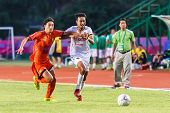 Sisaket Thailand-june 8: Weerawut Kayem Of Muangthong Utd. (white) In Action During Thai Premier Lea