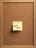 pic of miss you  - Color shot of a cork board with a sticky note reading  - JPG