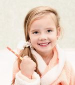 Smiling Cute Little Girl Brushing Teeth