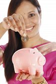 Young Indian Woman With A Piggy Bank