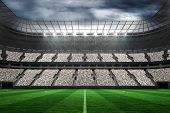 stock photo of football pitch  - Digitally generated large football stadium with fans in white - JPG