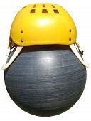 Yellow Sports Helmet On A Plastic Ball Black Isolated On White Background.