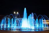Fountain with colorful illuminations at night