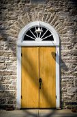 Arched Door In Old Stone Wall