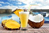picture of pina-colada  - Pinacolada pina colada cocktail with beach background