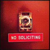 "picture of soliciting  - ""No Soliciting"" apartment door sign in New York City with Instagram effect filter. - JPG"