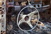 Burnt Car Interior With Steering Wheel After The Accident