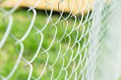 stock photo of chain link fence  - durable construction fence in the country background - JPG