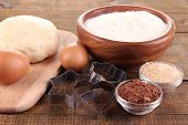 Ingredients for making cookies on wooden background