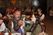 MUSKOGEE, OK - MAY 24: A knight greets female guests during the Queen's tea at the Oklahoma 19th ann