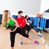 Boxing aerobox group low kick training at fitness gym mirror