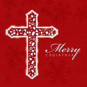 Merry Christmas celebration concept with Christian cross on snowflakes decorated red background.