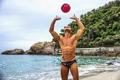 Muscular Young Man With Volleyball Playing Volley