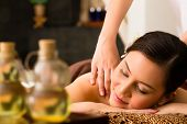 foto of therapist massage  - Chinese Asian woman in wellness beauty spa having aroma therapy massage with essential oil - JPG