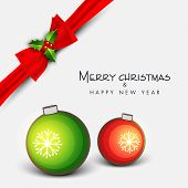 Merry Christmas and Happy New Year greeting card decorated with red ribbon and colorful X-mas balls on grey background.
