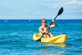 Man Kayaking in the Tropical Ocean in Yellow Kayak on Sunny Morning in Hawaii