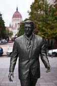 stock photo of ronald reagan  - Ronald Reagan Statue and Budapest Parliament Building - JPG