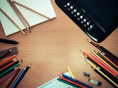 Office Tools, Colored Pencils And A Graphics Tablet On The Table