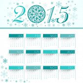 Yearly 2015 calendar design with floral decorated X-mas Ball.