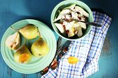 Tasty dessert with pears and fresh pears, on wooden table