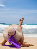 Woman with straw hat on the beach in Bali