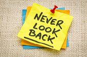 never look back reminder on a green sticky note against burlap canvas