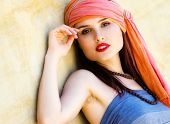 Woman wearing a turban in the desert