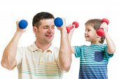 daddy and kid son doing exercise with dumbbells together