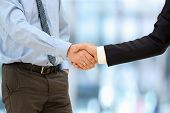 Close-up Image Of A Firm Handshake  Between Two Colleagues Outside