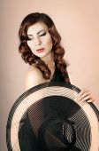 stock photo of cabaret  - cabaret girl with a hat - JPG