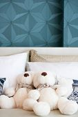 Happy Teddy Bears Siting On Comfortable Bed