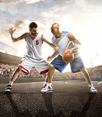 Basketball players in action on background of sky