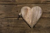 Rustic old wooden background with a key. Idea for a greeting card.
