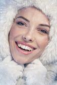 Woman Wearing A White Fur Cap