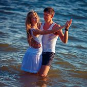 Couple in love dancing in the water