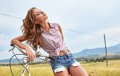 Summer vacation in Italy. Girl on bike