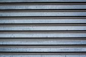 Close-up detail of closed steel security shutters