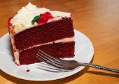 picture of red velvet cake  - Red velvet cake on a white plate with a fork ready - JPG