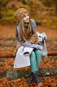 young smiling woman portrait outdoor in autumn