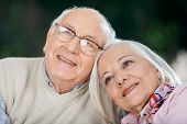 Closeup of loving senior couple looking away at nursing home