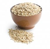 oat flakes in bowl on white background