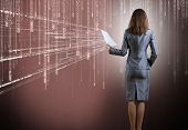 Rear view of businesswoman against binary background