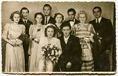 GERMANY, CIRCA THIRTIES:: Vintage photo of newlyweds with their family