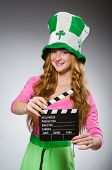 Woman with movie board in saint patrick concept