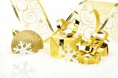 Golden Christmas Baubles, Gifts,snowflakes With Golden Ribbon On Snow
