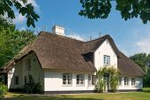 House with thatched roof on the island Sylt, Germany