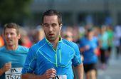 Focused Caucasian Man Running