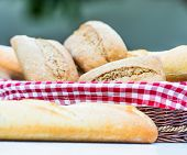 fresh baguette and bread on the table